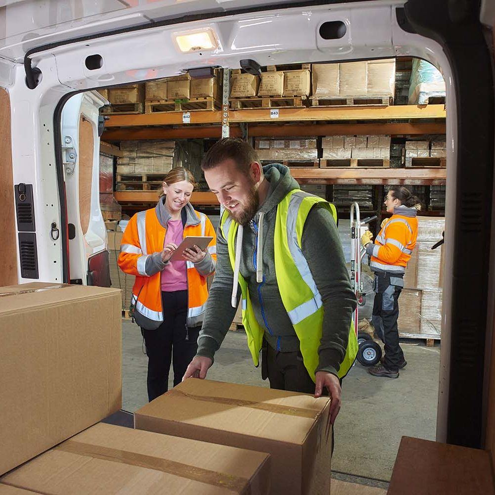 Insured cargo being unloaded from a van.