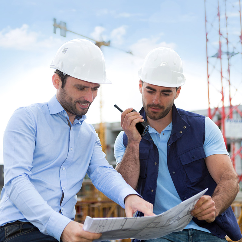 Insurance Broker works with construction business owner to understand his specific needs.