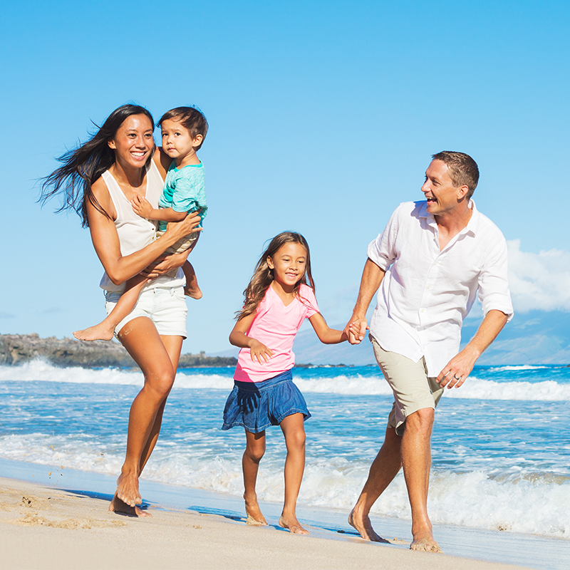 New Zealand family relax at the beach knowing they are well insured.